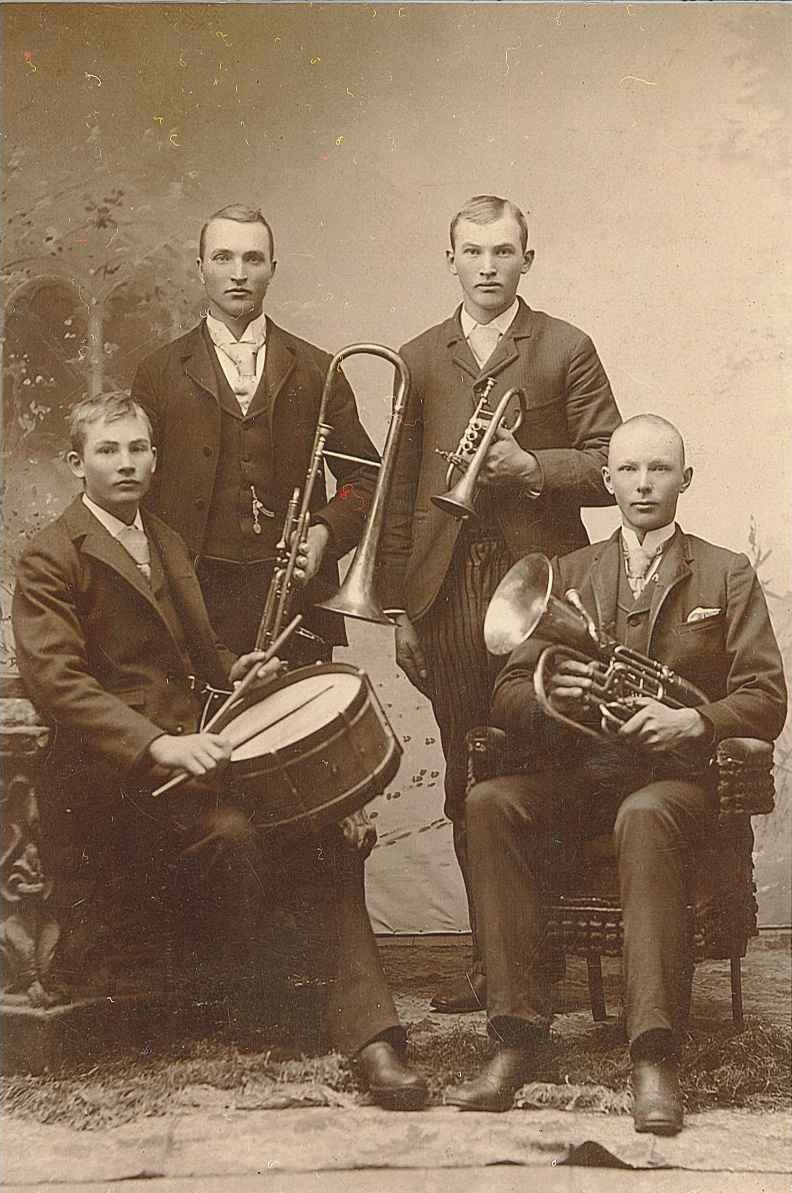 four men with instruments