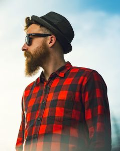 bearded man wearing hat and sunglasses