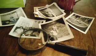 old photos and magnifying lens