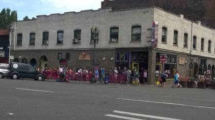 line of people waiting in front of voo-doo donuts
