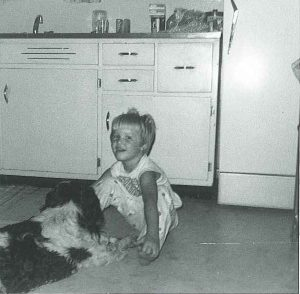 Old photo of girl and dog