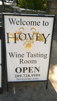 sign for wine tasting hours