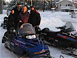 snowmobiles, minnesota, family in the snow