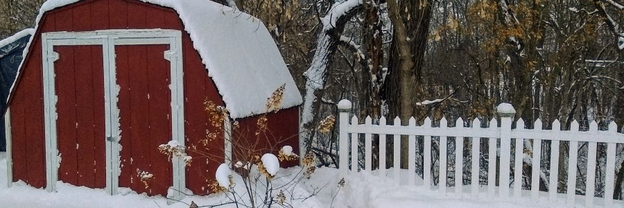 Red shed covered in snow